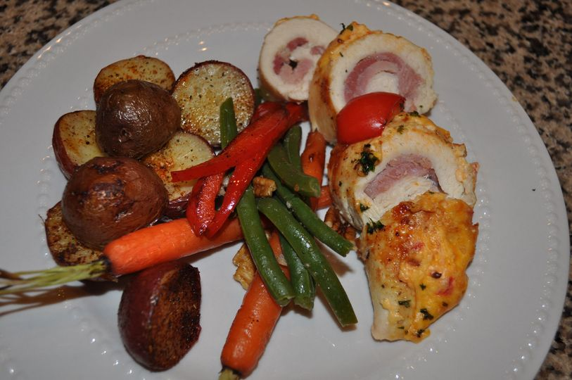 Stuffed chicken with sides