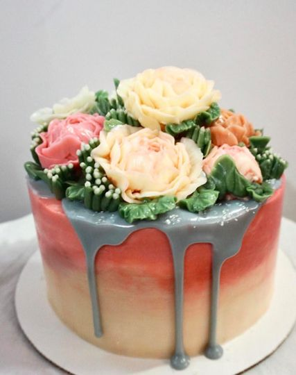 Gradient wedding cake with flowers on top