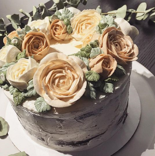 Wedding cake with yellow flowers on top