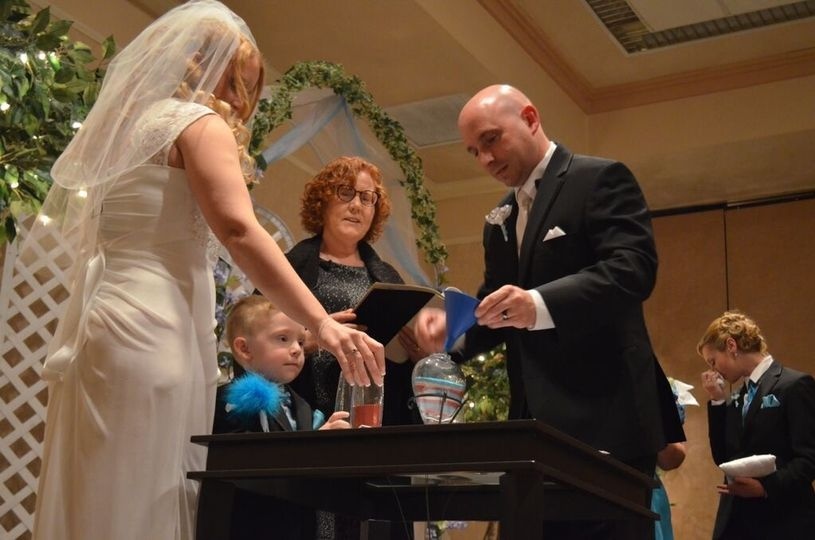 Erin and Michael chose to celebrate a sand ceremony that included their son Carter. The three of...
