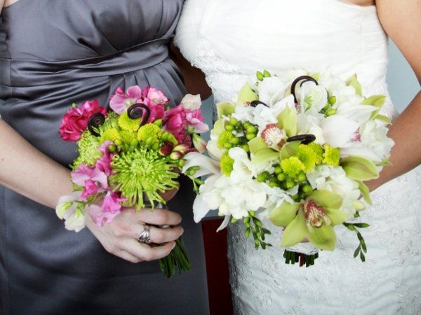 Bridal bouquet of green and white orchids, freesia and sweet peas and monkey tails.  Bridesmaid...