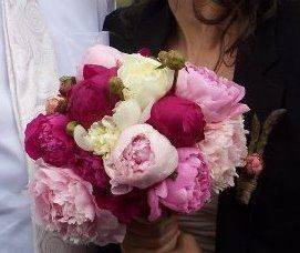Pink peonies for the bride and an asparagus boutonniere for the veggie loving groom!