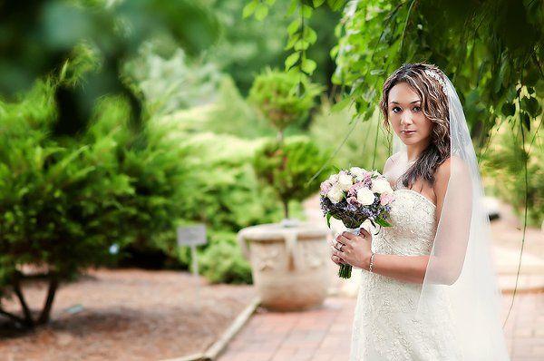 Bridal portrait in lush, green setting