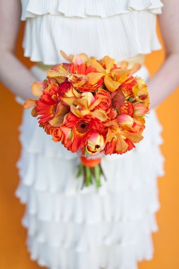 Tangerine Tango is the Color of 2012! This bridal bouquet is made with all orange blooms, including...