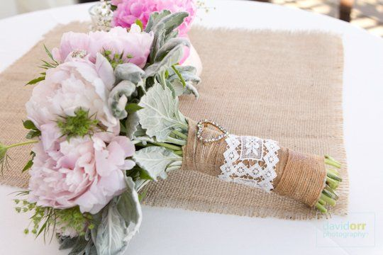 A shabby chic bridal bouquet with burlap and lace