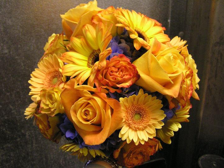 Yellow flower arrangement with purple notes
