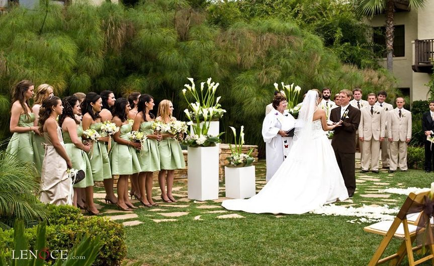 Rev Pat at garden wedding  at Estancia La Jolla  with photographer Lenoce.   This was a large...