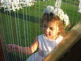 flower girl with harp