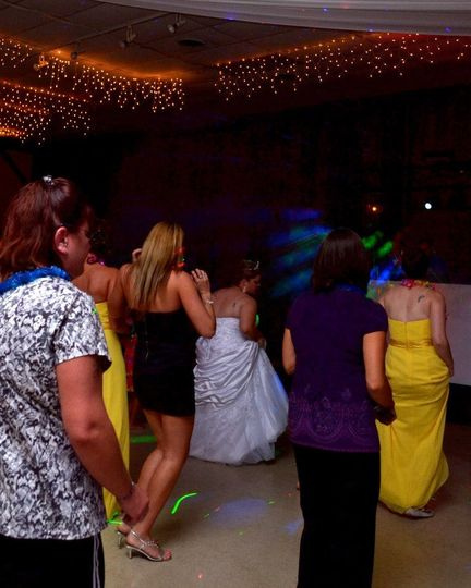 The couple and guests dancing