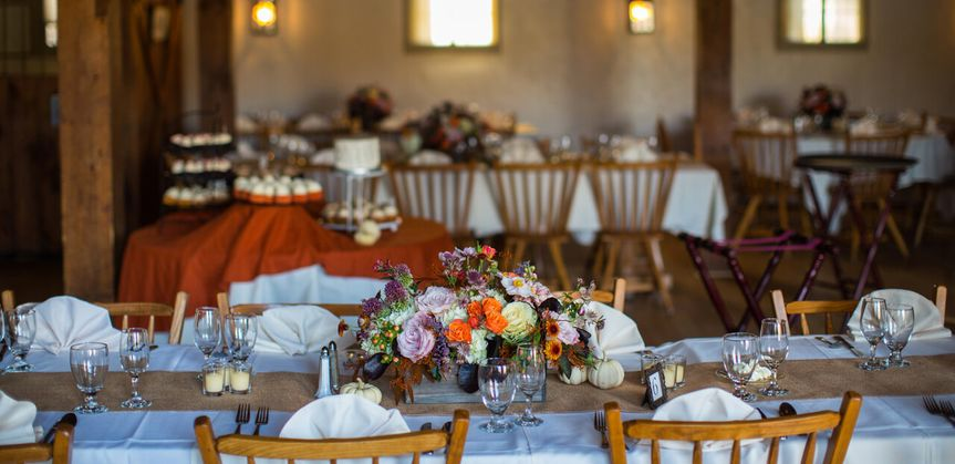Table setting with candle and floral centerpiece