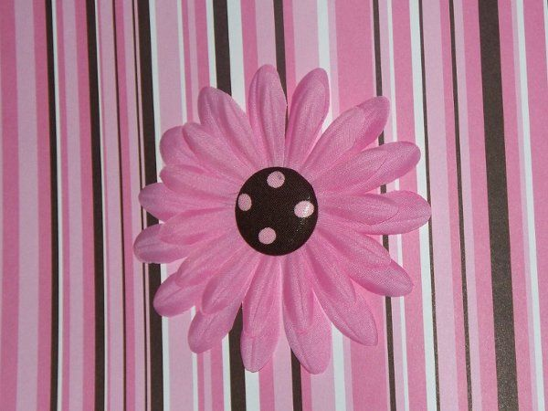 """Order favors that your guests will """"keep"""" using. Our flower magnets can be custom ordered to match..."""