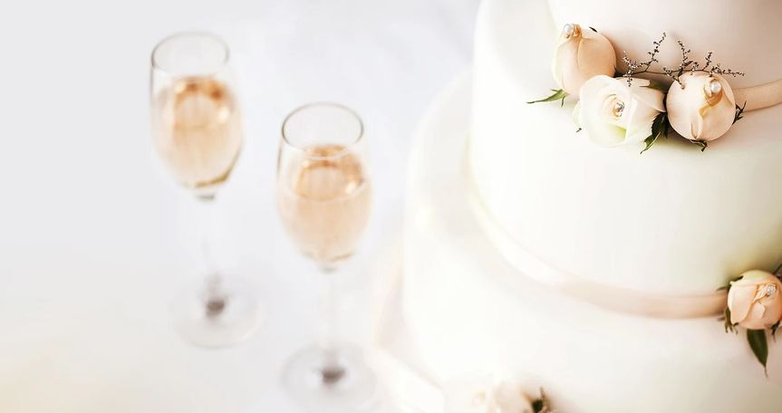 Champange glass and wedding cake