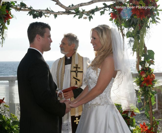 Breezy beach wedding, two hidden microphones for superb sound and beautiful pictures. No standing...