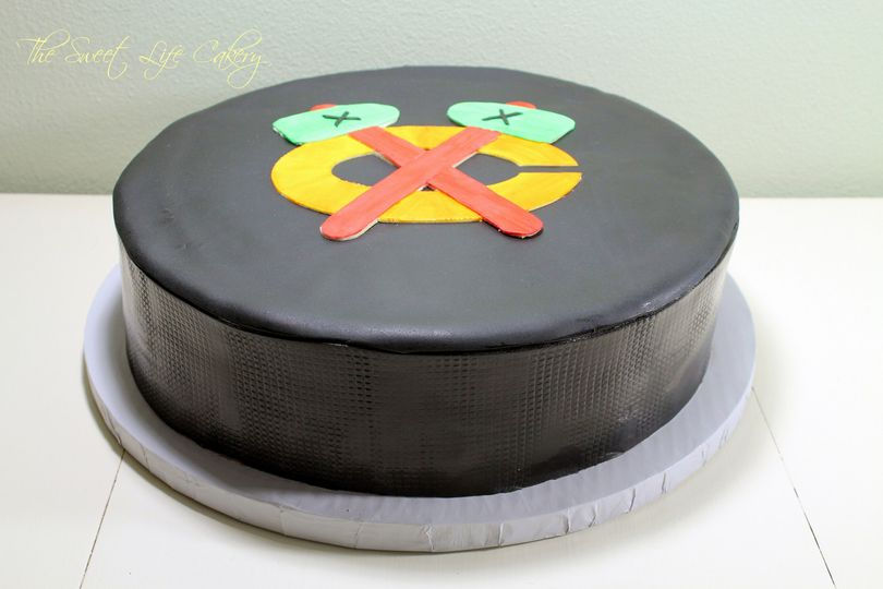 Hockey puck groom's cake covered in fondant