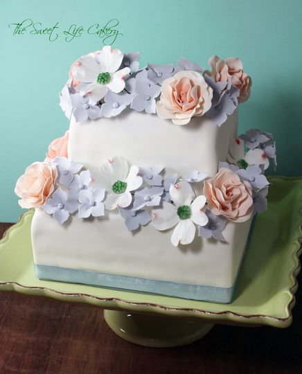 2 tiered cake covered in fondant with gum paste flowers