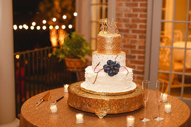 3-tier wedding cake with a gold top layer