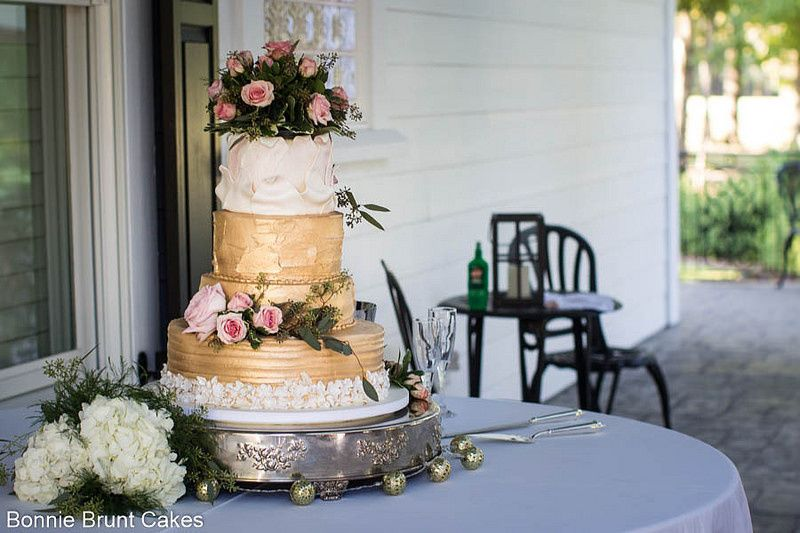 Buttercream wedding cake with gold layers