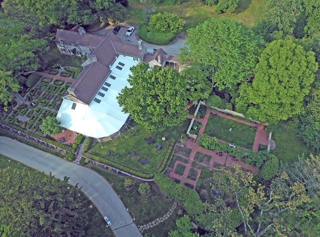 Aerial view of the house, tent, boxwood, perennial and rose gardens.