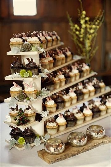 Country Chic cupcakes displayed on wood shelves.  Chocolate with chocolate buttercream and vanilla...