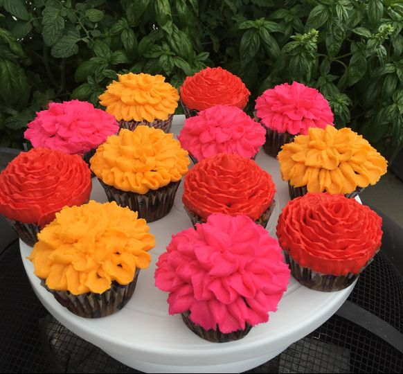 Floral cupcakes.  Rich chocolate cupcakes with vanilla bean buttercream.  Served at an outdoor...