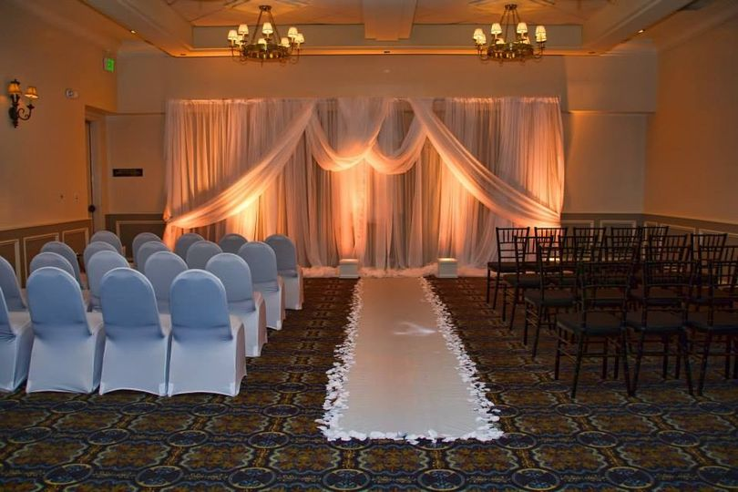 Indoor ceremony setup and lighting