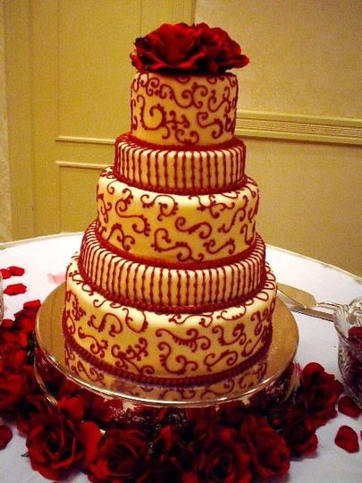 Crimson and white for a Bama bride.  Red velvet cake on the inside complements the white chocolate...