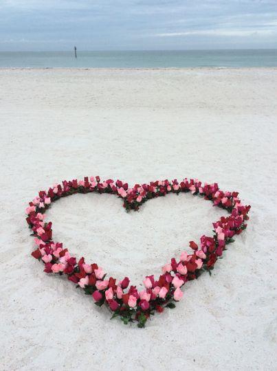 Flower heart on the sand