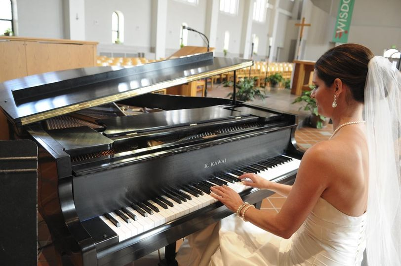 Bride playing the piano