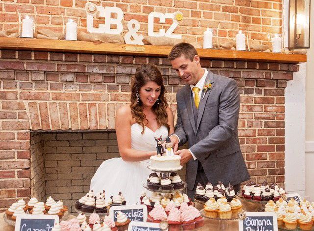 800x800 1432860347318 christan wedding cutting the wedding cupcake
