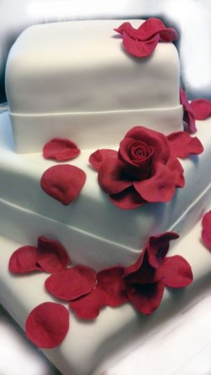 Three Tier Square Rose Petal Wedding Cake: Top Layer Carrot Cake with Cream Cheese Frosting, Second...