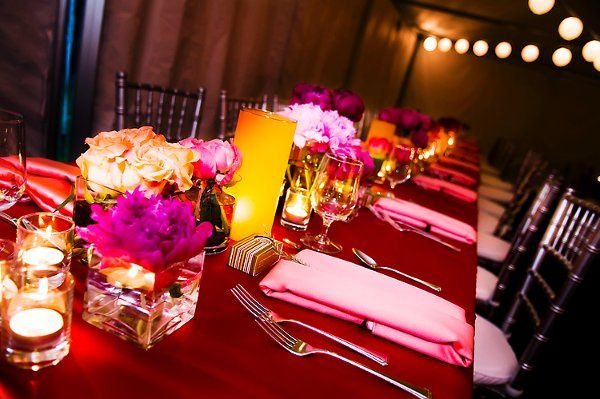 Long tabletop with red, coral and amber.