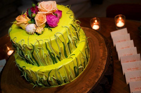 Grass cake with place cards on sod.