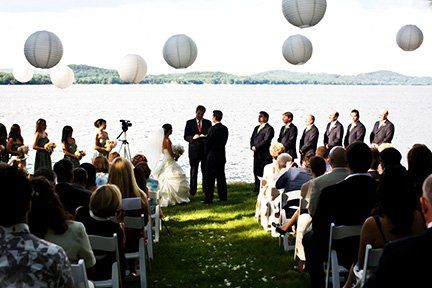 Lakeside ceremony with lanterns.