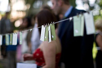 Place cards on clothes line.