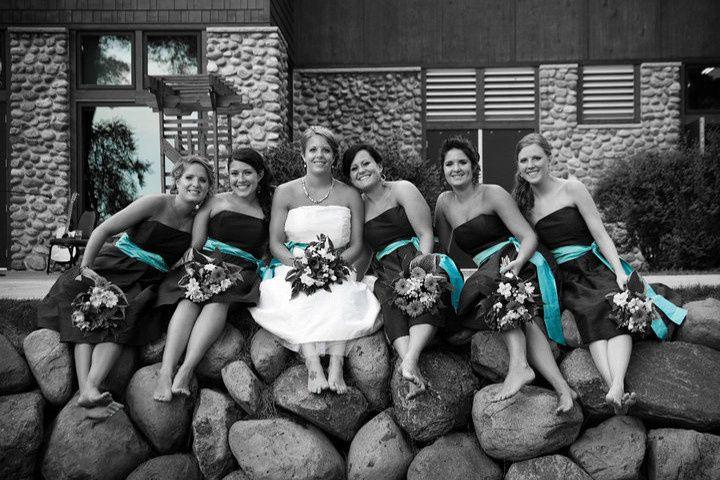 Wedding party on rock wall near Eagle Lodge