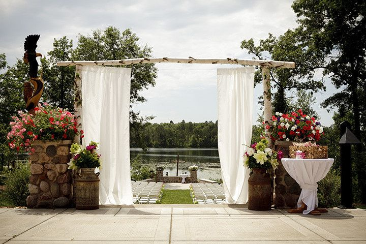 Birch arbor with view of lakeside ceremony lawn