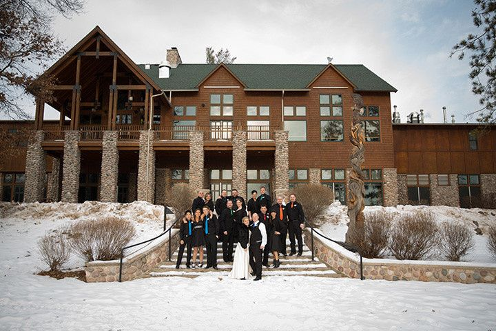 Winter wedding party by Eagle Lodge