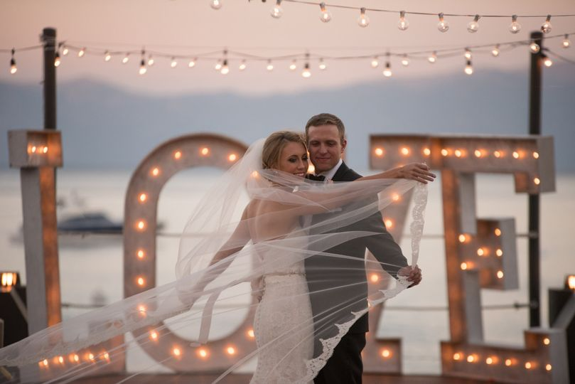 Couple photo by the illuminated LOVE decor