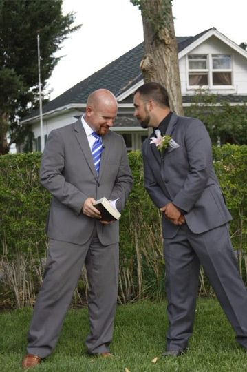 The groom and the officiant chatting
