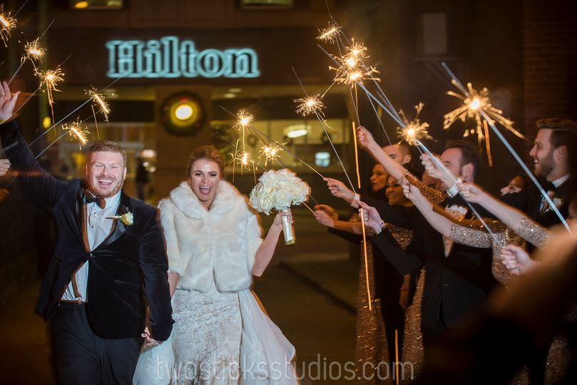 bride and groom sparklers infront of hilton 2