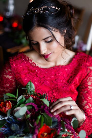 Dark and romantic bridal makeup artistry by Savannah Rae Beauty, featuring soft glowing skin and a...