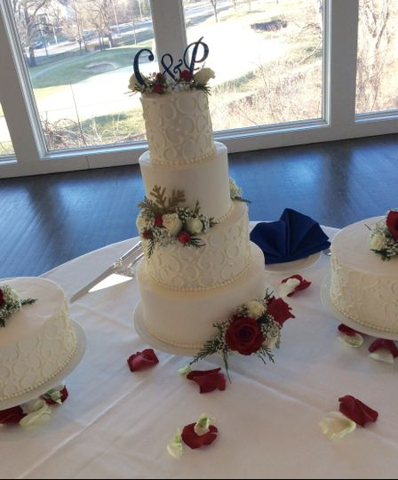 White wedding cake with C & P on top