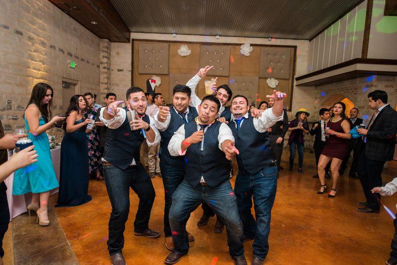 The groom dancing with his bestman