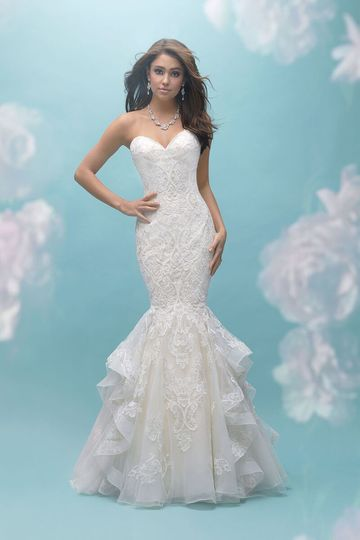 7aa0fa4c09d7 Allure Bridals 9456 This strapless, ruffled mermaid gown features  symmetrical patterned lace.