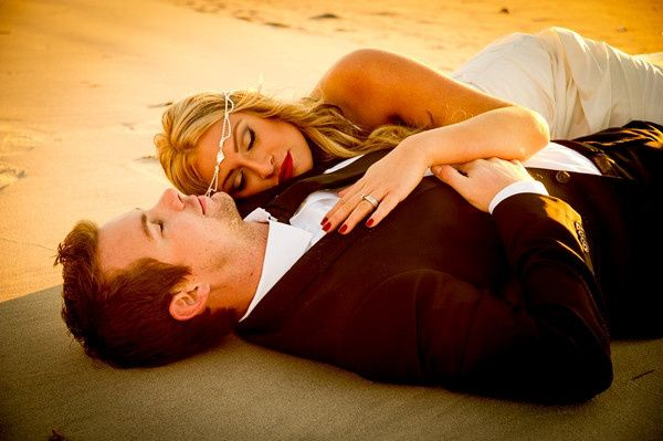 Couple laying on the sand