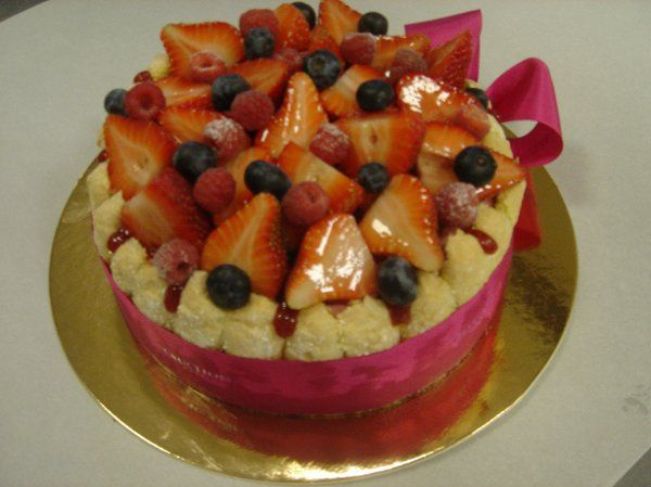 Fruit mousse and ladyfingers topped with seasonal fresh berries