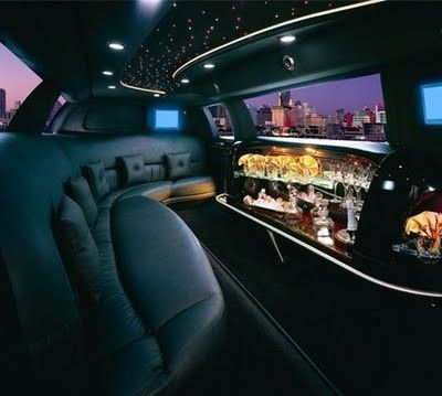 Interior of our 8 passenger Lincoln Town car limousine black on black.