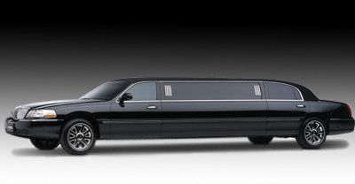 Our 8 passenger Lincoln Town car black on black.
