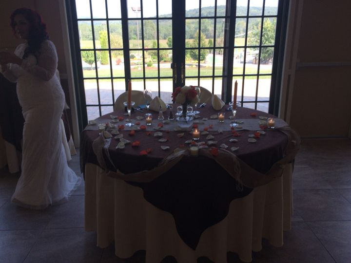Sweetheart Table in front of our French door leading to our patio is a nice touch for this bride.