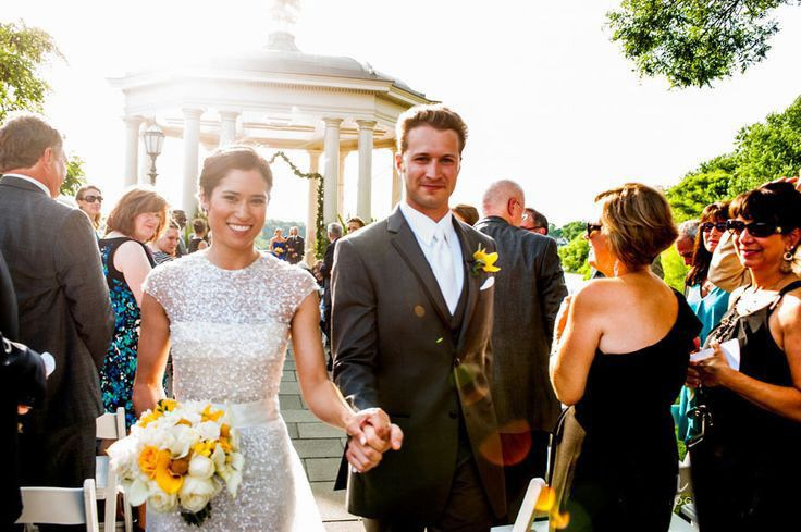 Beth and Dan rejoice as they strut their stuff down the aisle after their beautiful ceremony at the...